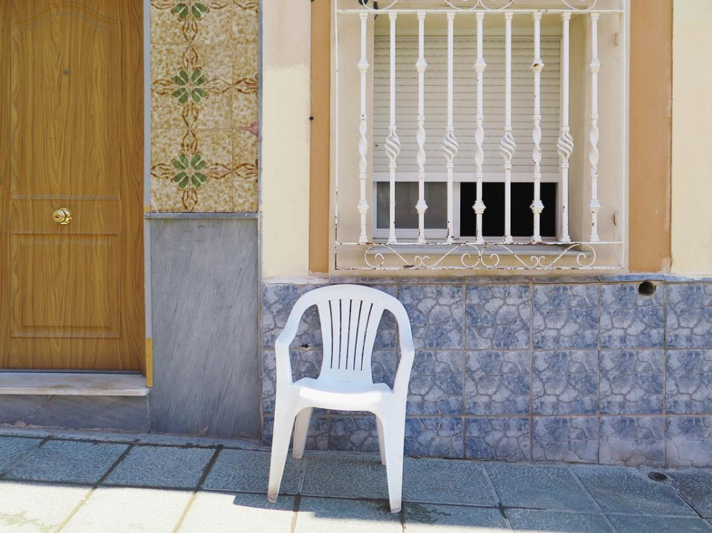 The white plastic chair on the beautiful tiled streets of Almería old town