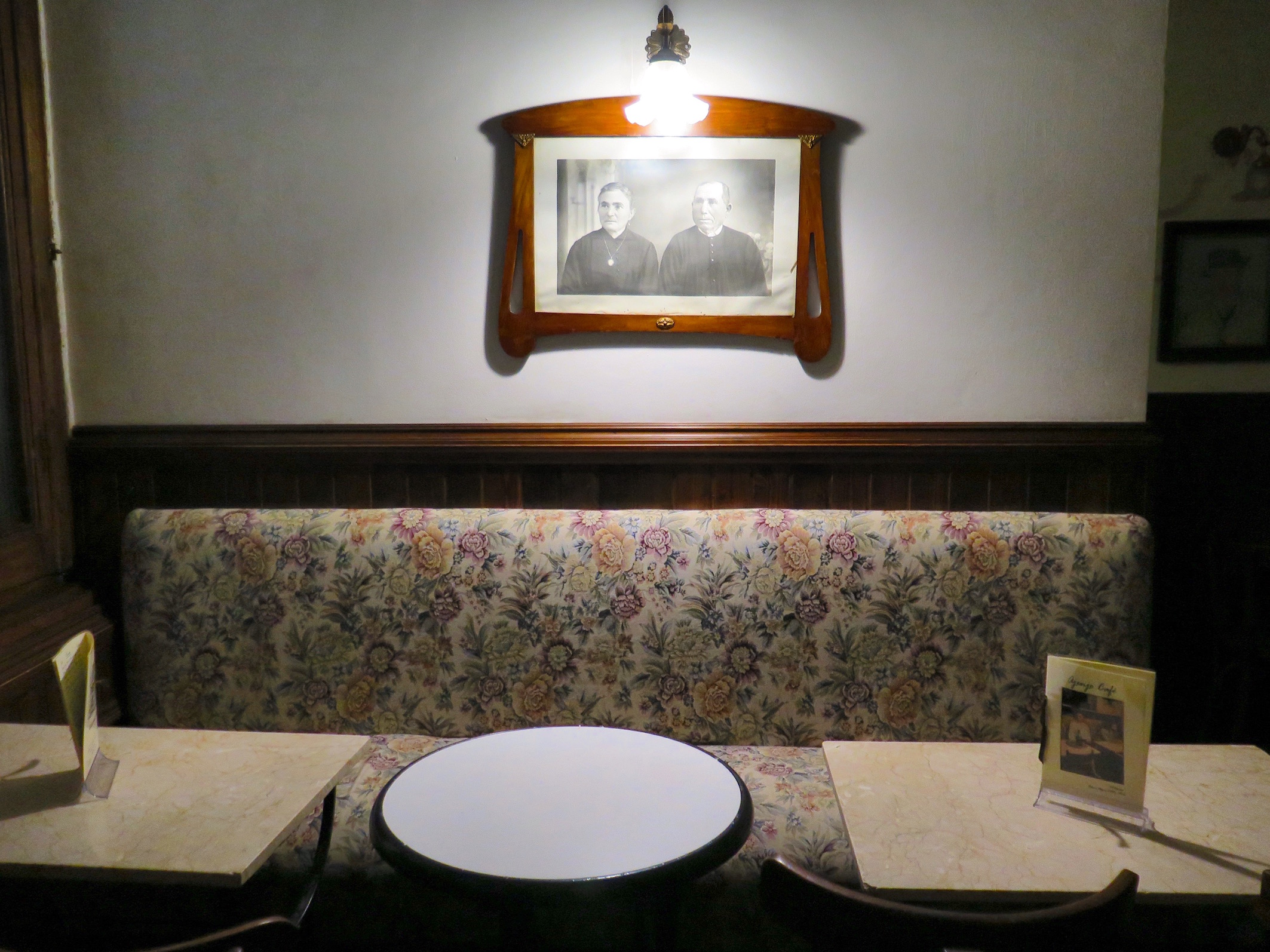 Original floral fabric from 38 years ago still lines the booths around the perimeters of each room
