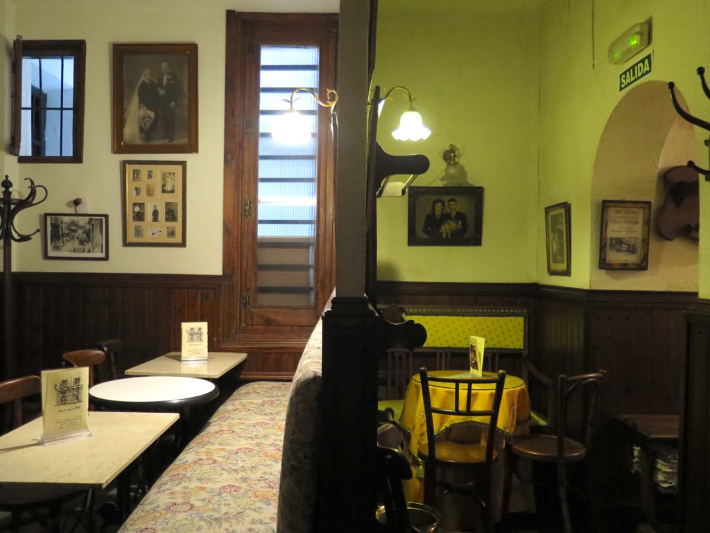 Two separate rooms: On the right is the cosy cove with a photo of Helios's Asturian parents on the wall