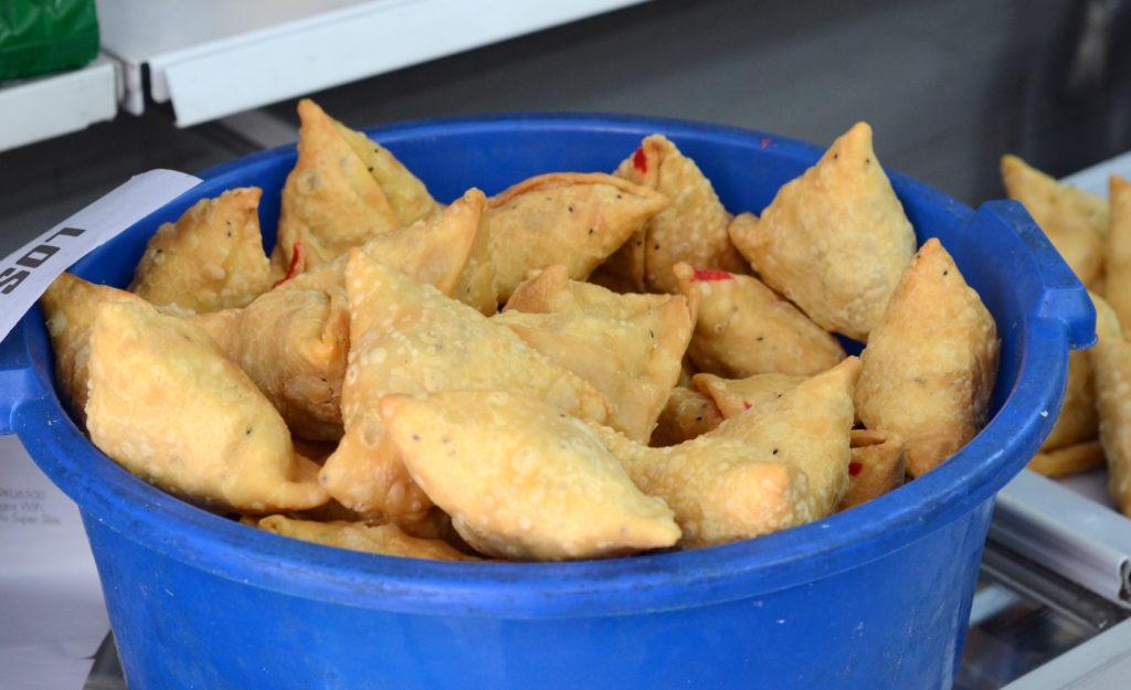 A freshly prepared batch of samosas