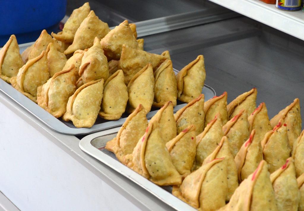 On the left: Veg samosas. On the right: Chicken samosas