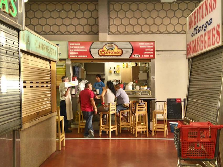 Upstairs, Peruvian men gather at the market's Peruvian bar.