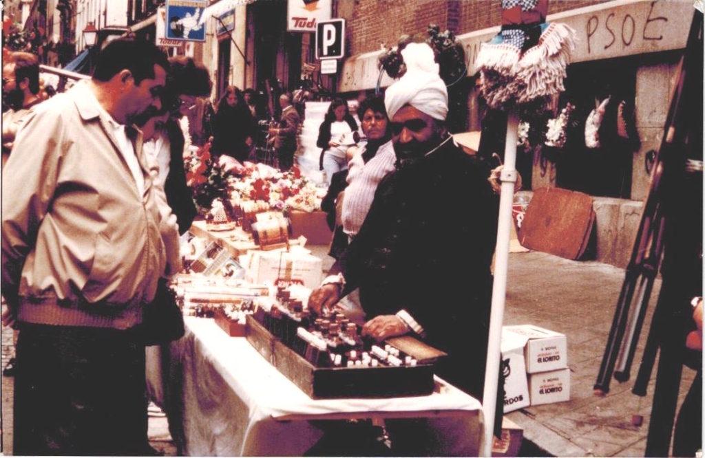 Karam Zafar selling his perfumes in the rastro