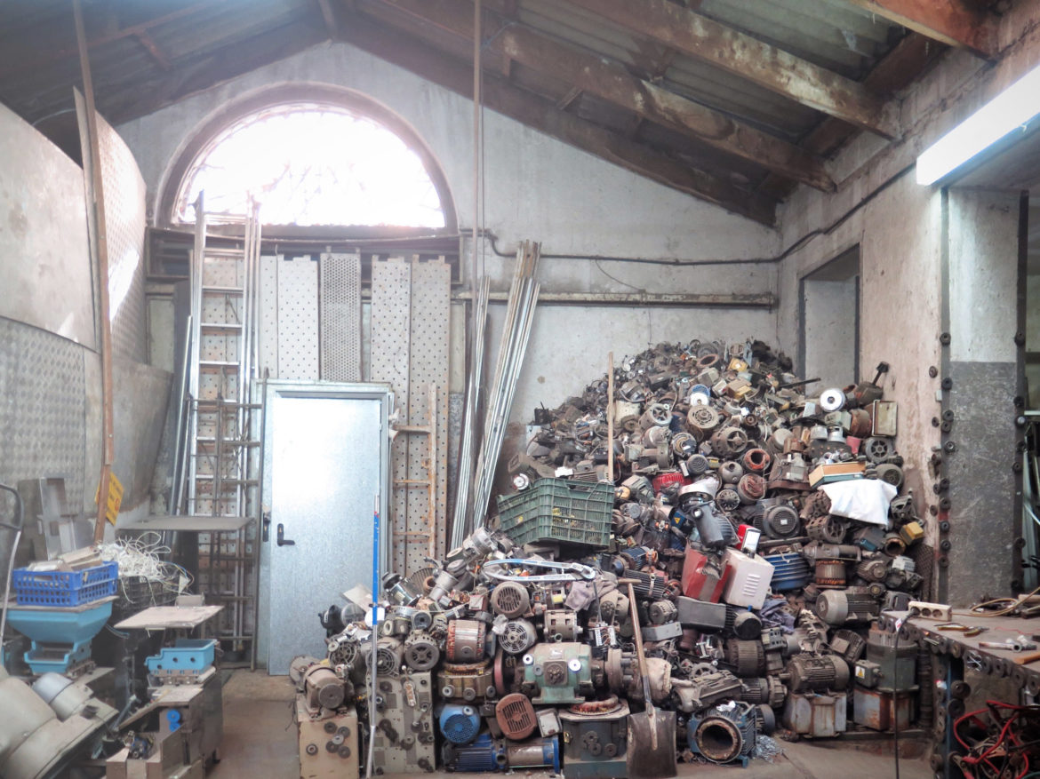 Old motors and engines precariously piled into the corner