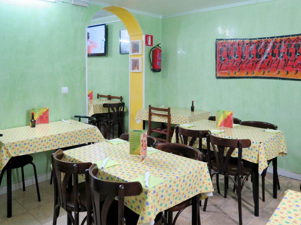 Shiny mint-green walls and plastic tablecloths