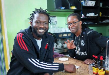 Mohammed and his friend, who both run Dakar