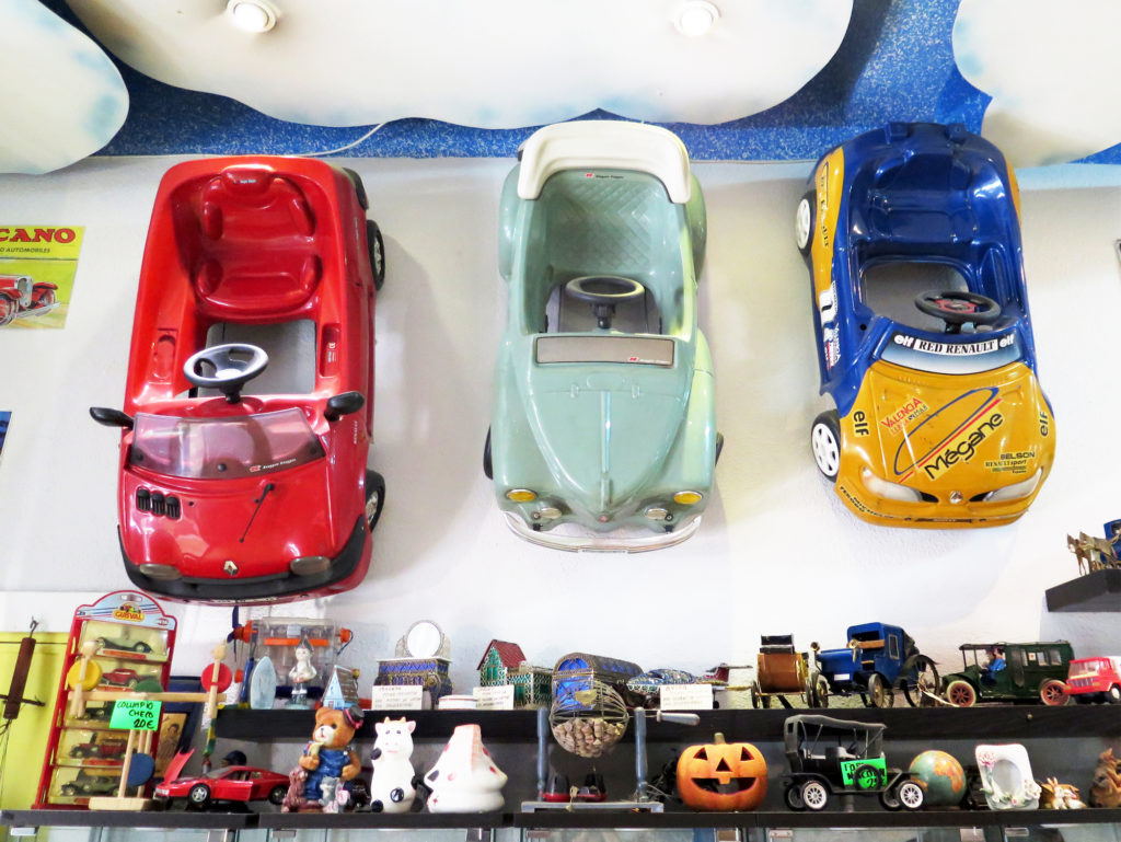 Vintage toy cars mounted on the wall