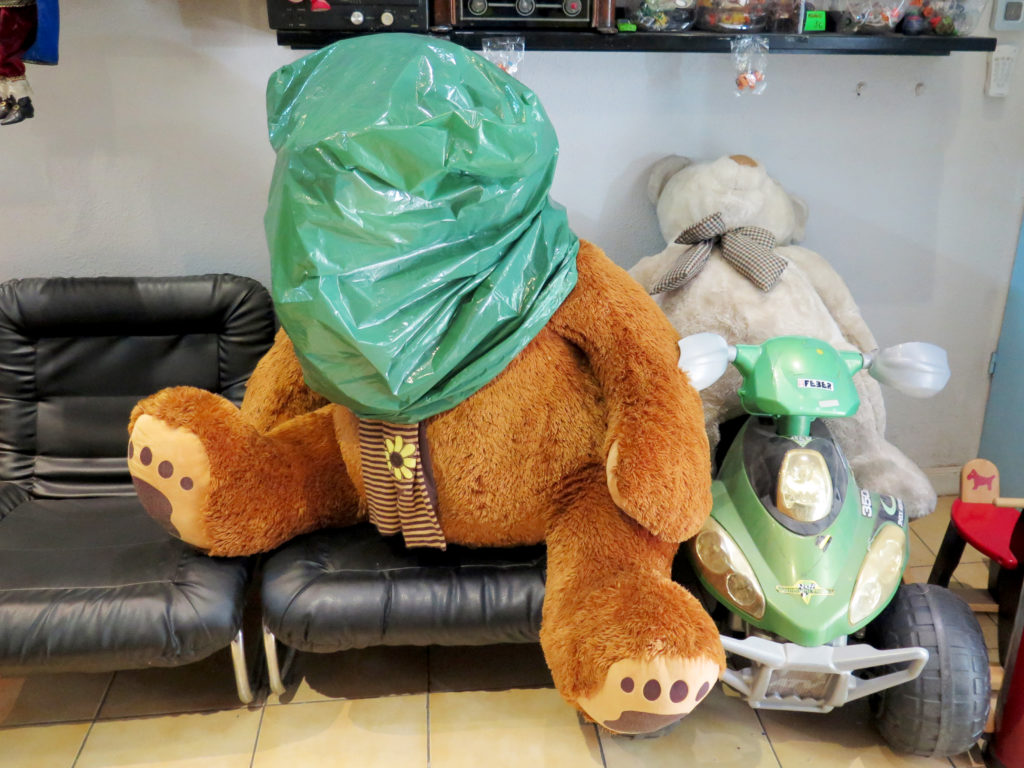 A large stuffed bear in for repair
