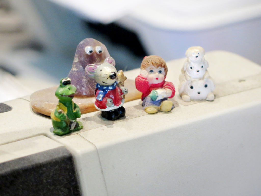 Miniature figurines ontop of the 90's till