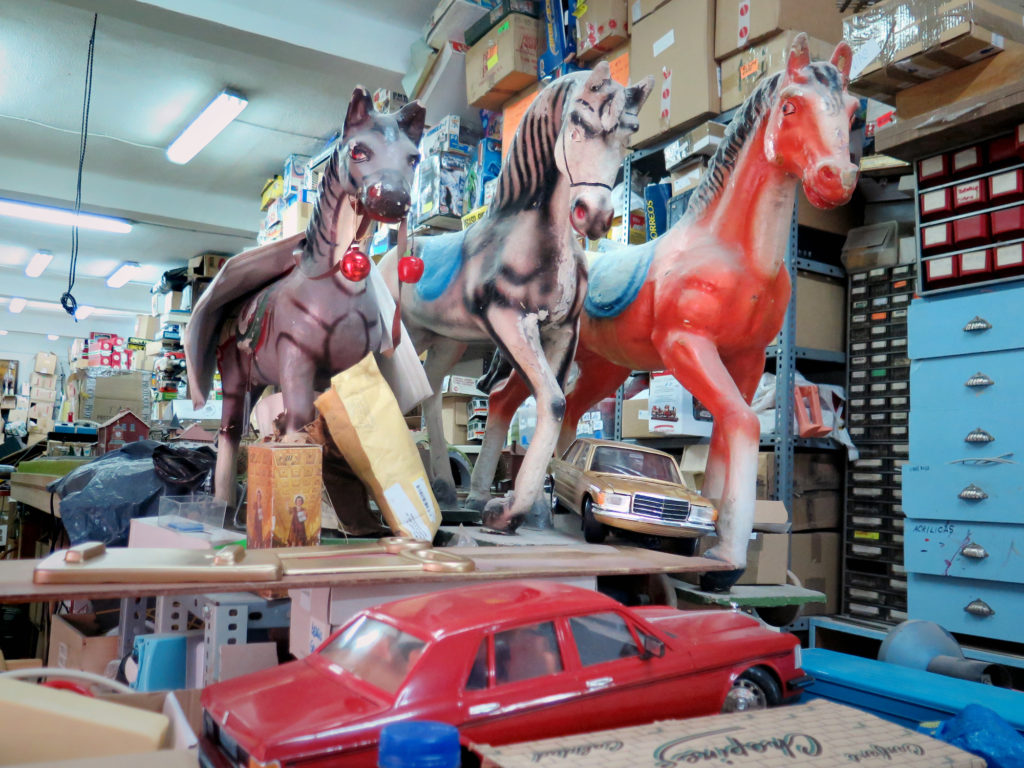 Wooden toy horses desperately in need of paintwork
