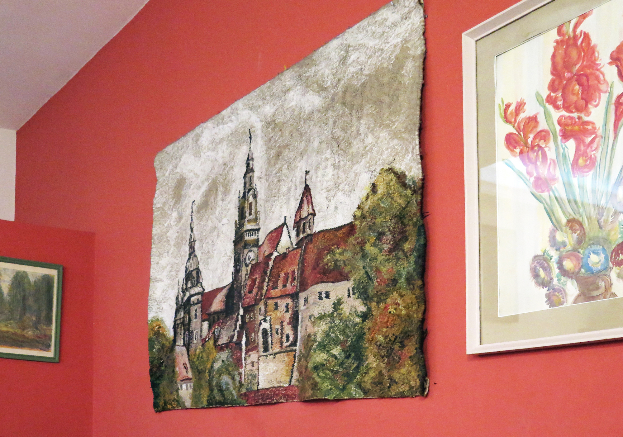 A hand-stitched mural of Krakow's old town
