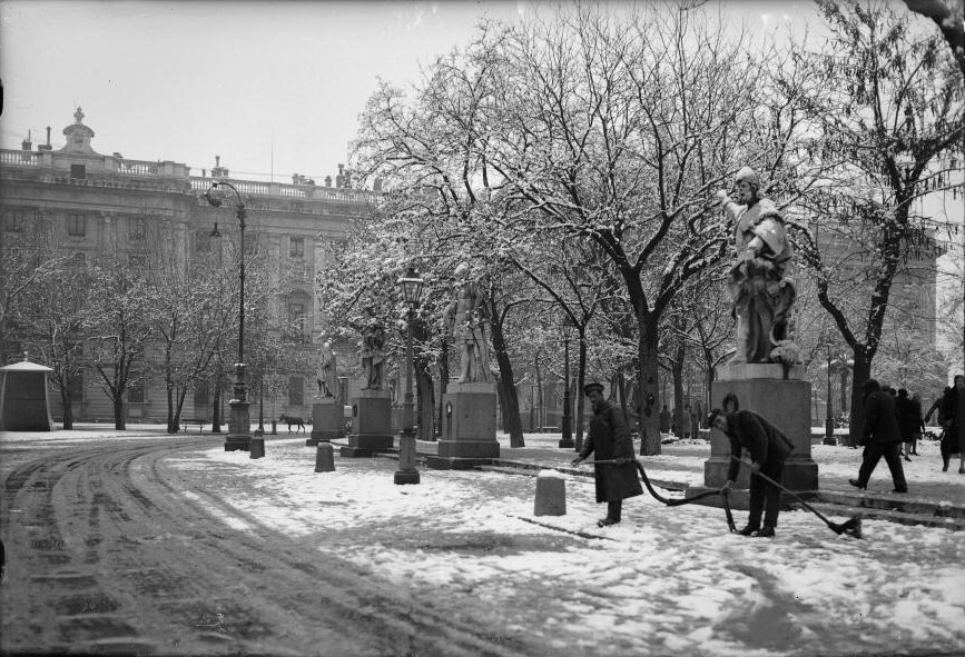 Men cleaning up the snow outside the King's palace