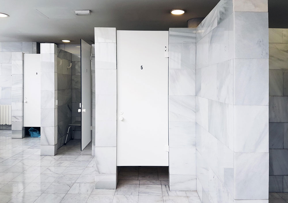 Shower cubicles inside the women's bathroom
