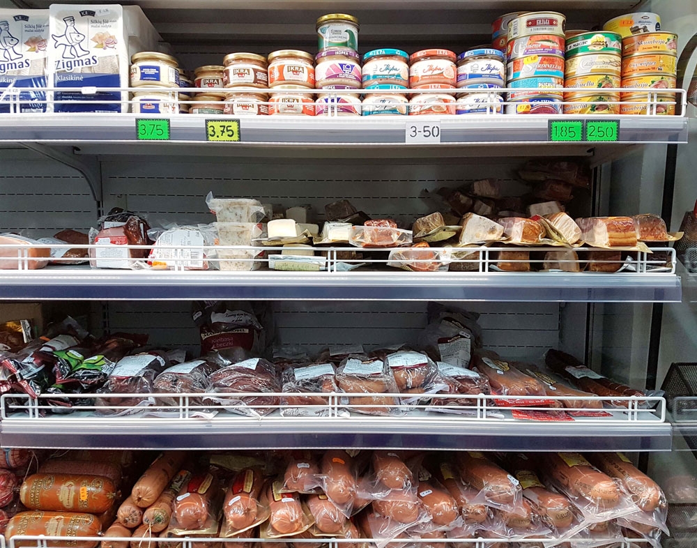 Lots of different types of meat and sausages