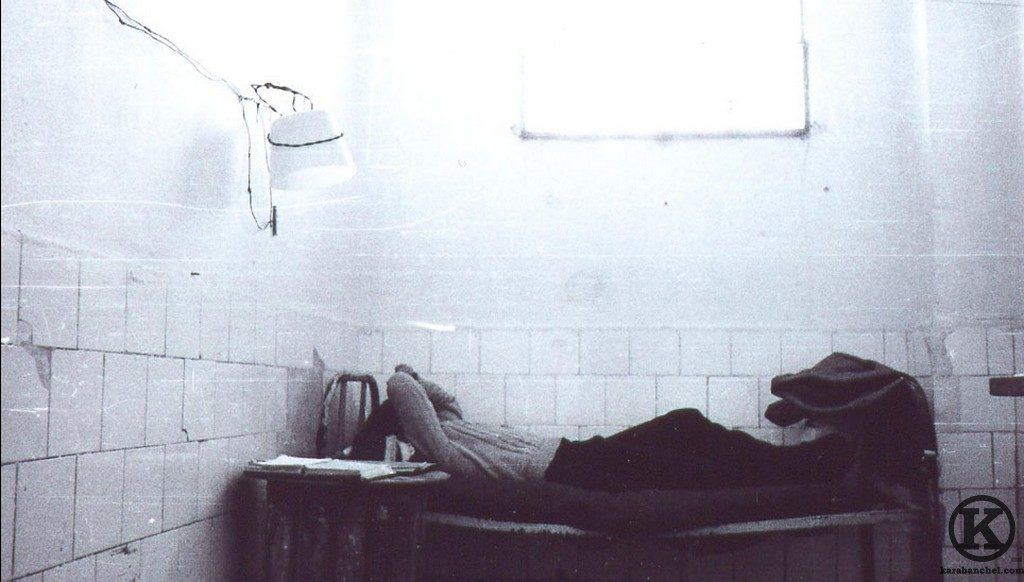 A man sleeping in one of the cells