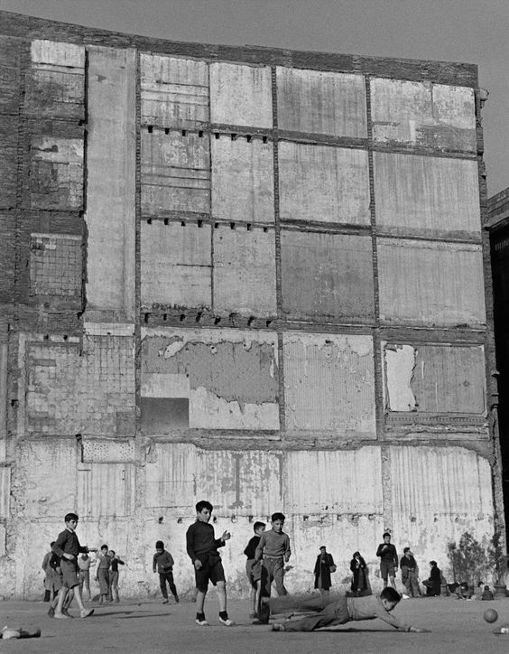 Kids playing football on a ghost building, 1950