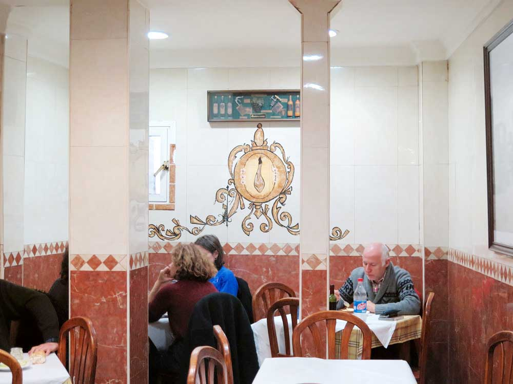 The salón (note the leg of jamón painted onto the back wall)