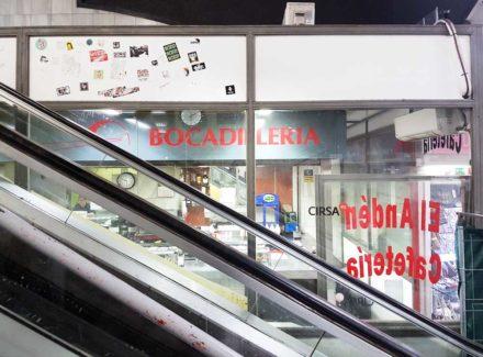 Tucked behind the escalators