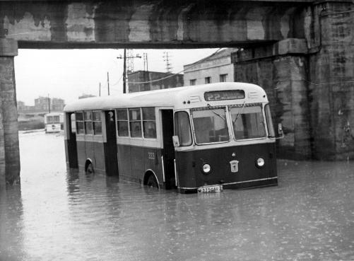 A local bus caught in the Vallecas floods, c. 1960