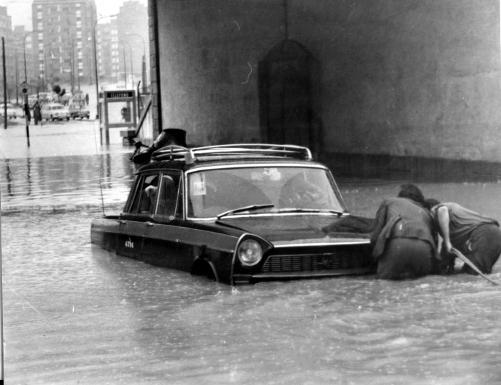 A taxi caught in the Vallecas floods, c. 1960