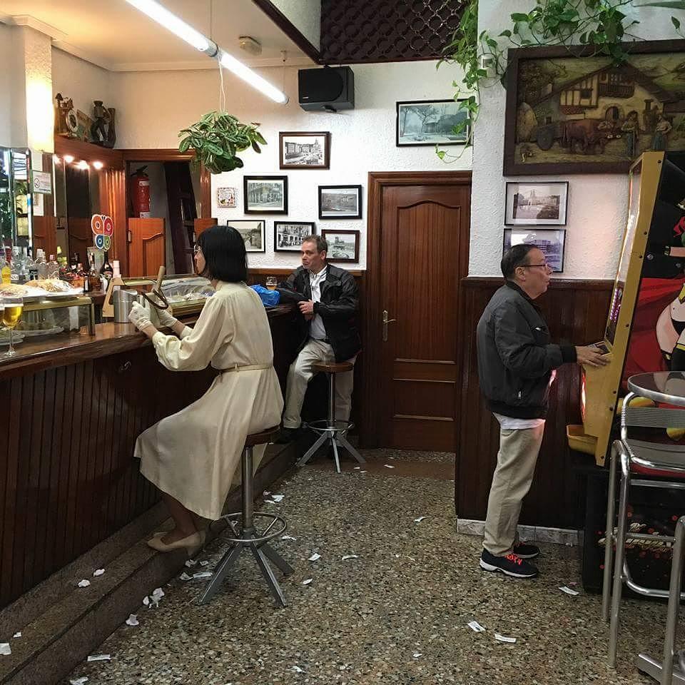 Miss Beige inside a no-frills bar