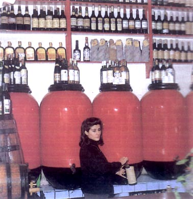 An old photo of the old wine amphoras in use (still in the bar)