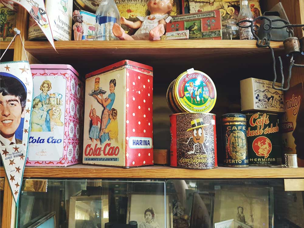 A collection of old Cola Cao tins