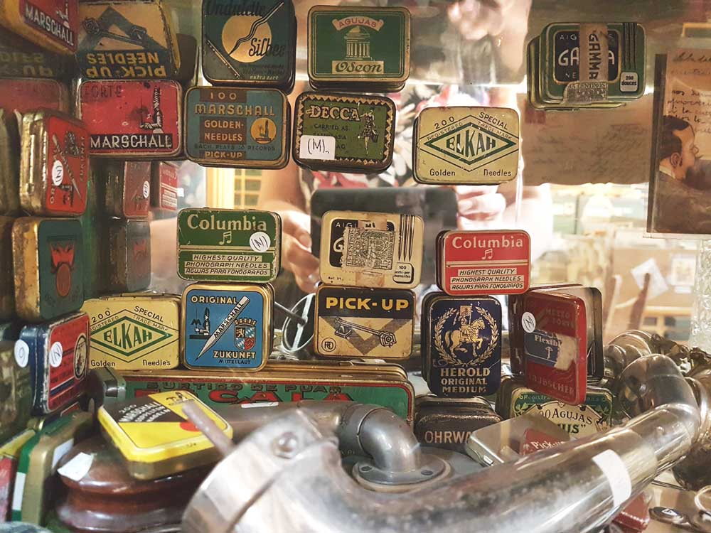 A collection of phonograph needles for record players