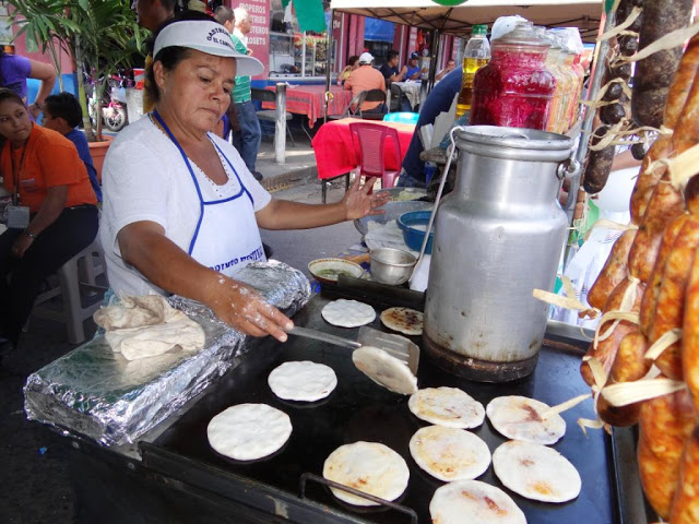 Pupusas being made jon the streets of El Salvador, ust as they were two thousand years ago