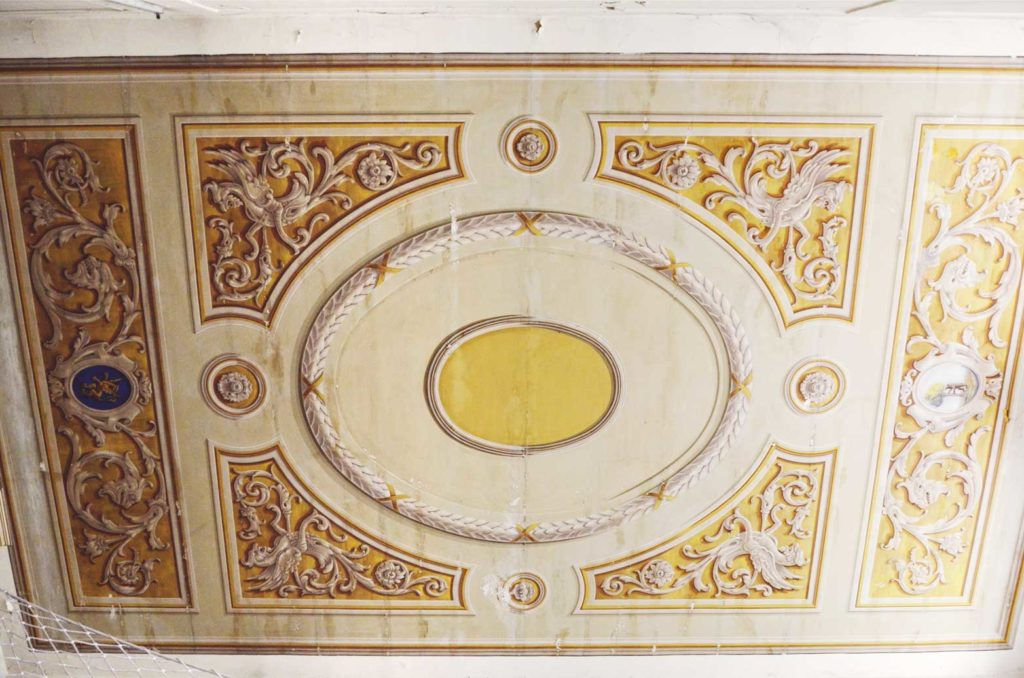 The painted mural on the ceiling