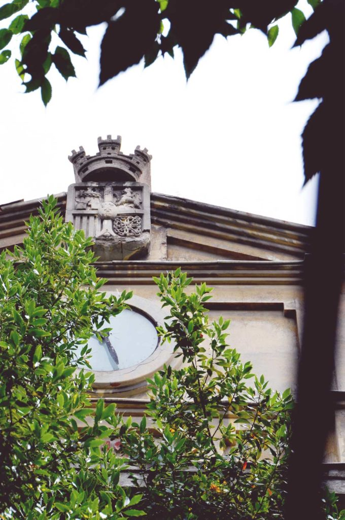 An old, broken clock in the secret garden