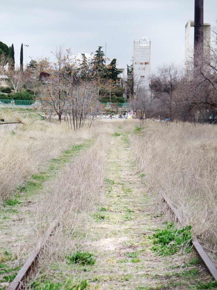 The old railway tracks became a path to one part of the slum
